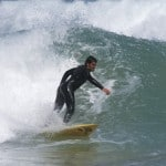 Surfing at Sandy Point