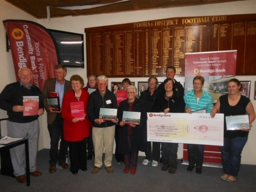 Happy recipients of Community Bank grants at the presentation last Tuesday night: (L to R) Ed Hanley (Dumbalk & District Progress Association), Rob Knight (Chair of Promontory District Finance Group Ltd), Bev Hanley (Dumbalk & District Progress Association), Carmel Van Kuyk (at rear) (Arthur Sutherland Reserve), Howard Plowright and Jennifer Jones (at rear) (Foster & District Historical Society), Joy Dyson (Dumbalk & District Progress Association), Sandra Binding and Darren Lomax (at rear) (Foster Football Netball Club), Mary Shaw (at front) and Dianne Cooper (TP Taylor Reserve Committee of Management, Kelly Boyd (Toora Netball Club).