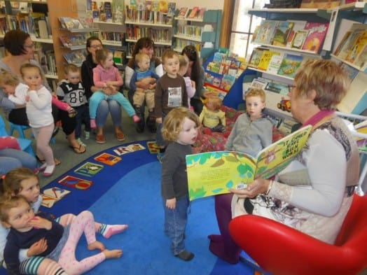 • Marg Haycroft leads a lively and popular storytime session in cramped conditions at Foster Library.